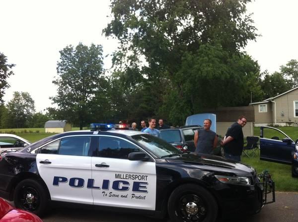 Cops arresting the scofflaws